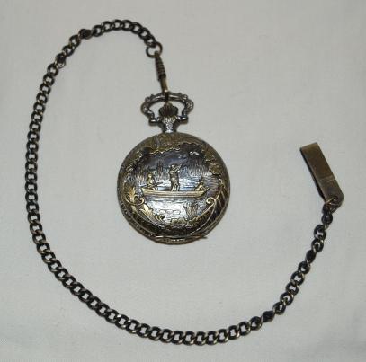 Taskukello, Kellotaulussa lukee Wm. Widdop Est. 1883